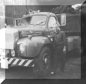 Bob (Old Hawk) loading scrap batteries in Quebec City, Quebec, Canada (1964)